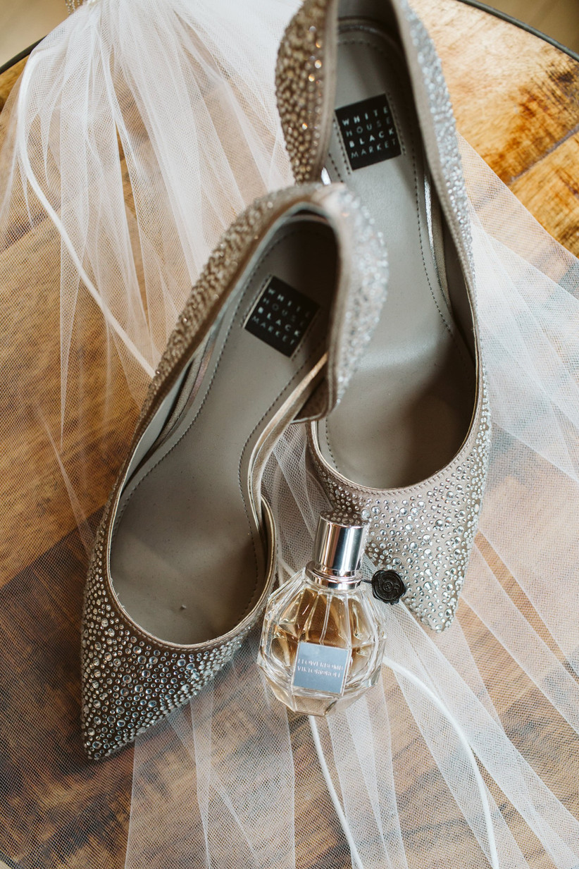sparkly silver rhinestone wedding high heels on veil with perfume bottle
