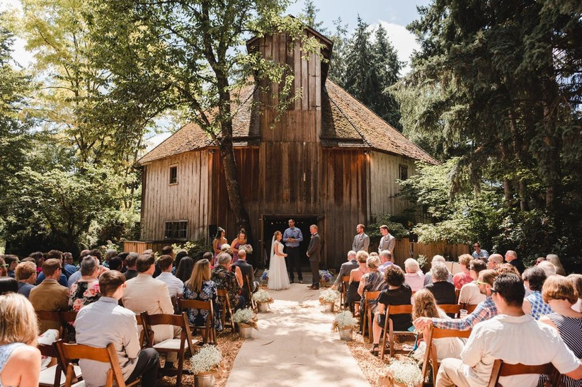 rustic barn wedding venue in oregon surrounded by forest