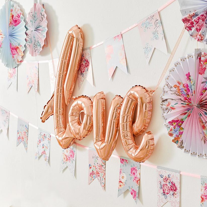 Rose gold foil balloon that spells love