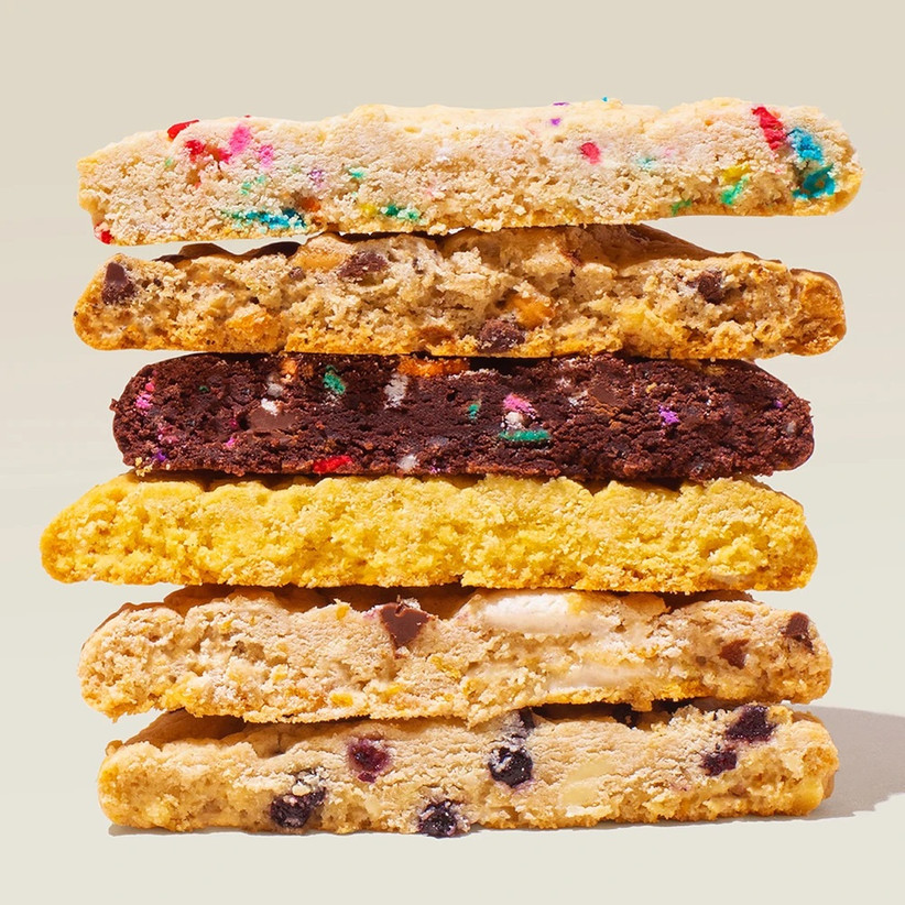 Stack of different types of cookies cut in half to show delicious center