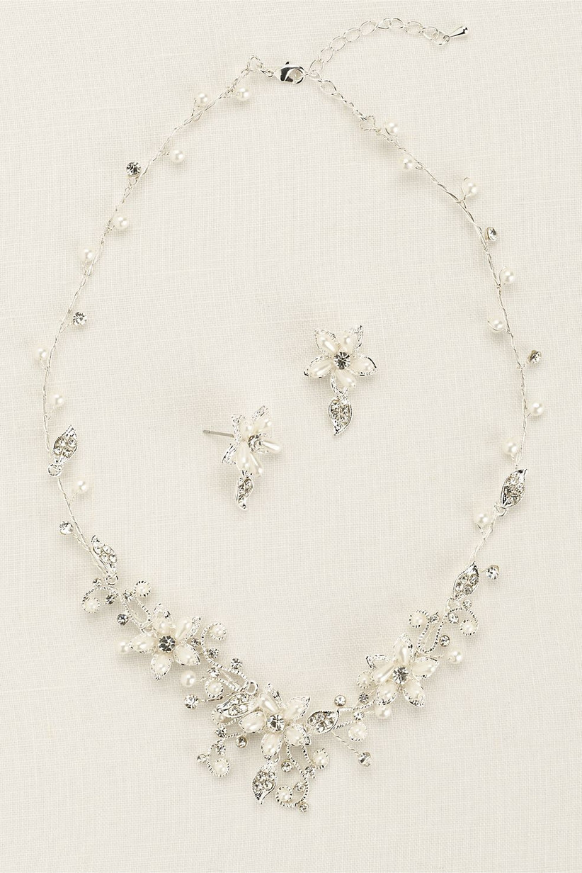 Elaborate floral and crystal statement necklace with silver chain and matching earrings