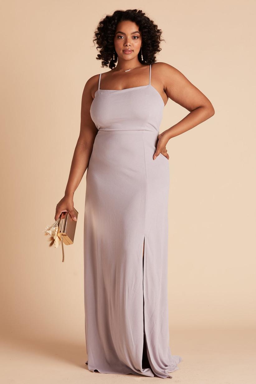 Model wearing minimalist pastel purple bridesmaid dress with subtle leg slit and simple straight neckline