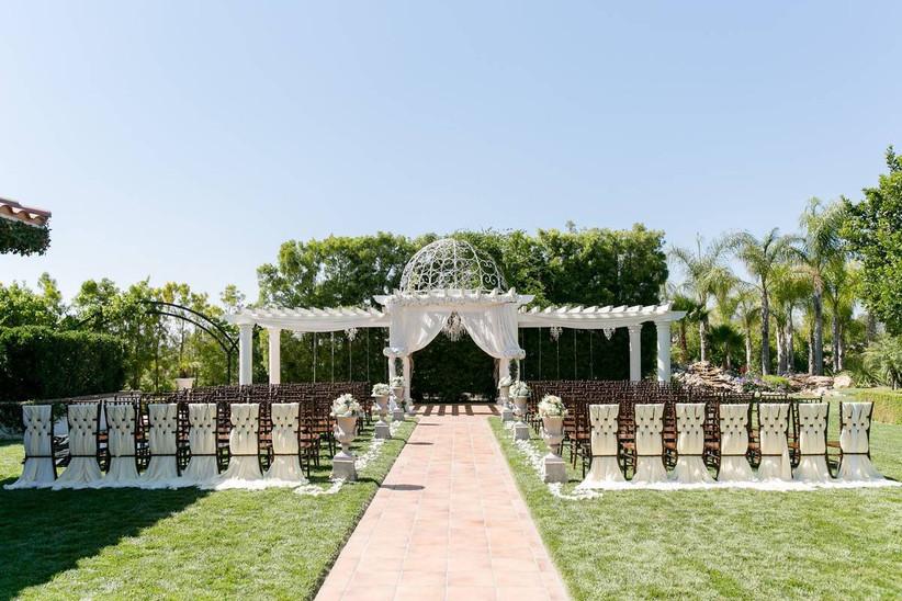 romantic outdoor wedding ceremony with dome pergola