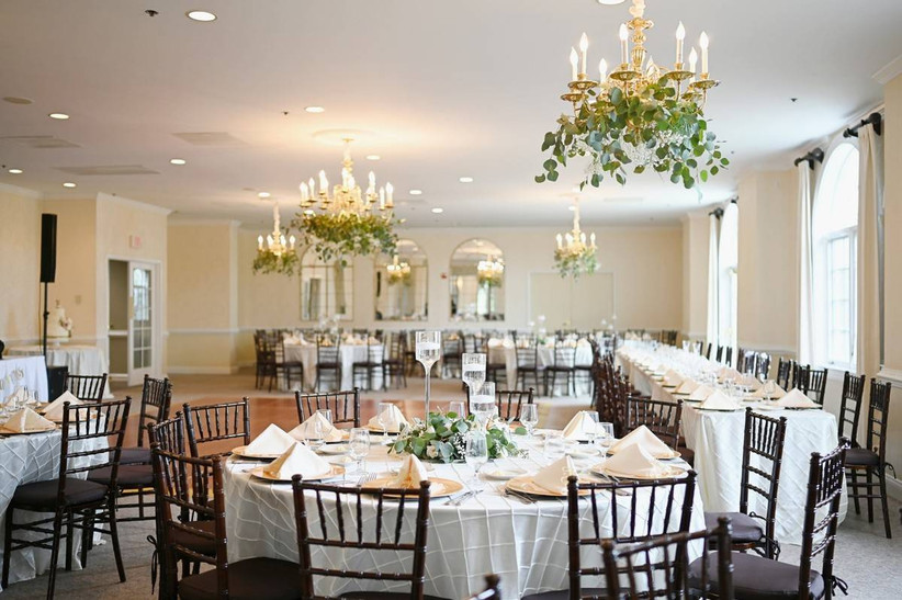 wedding reception room decoorated with greenery
