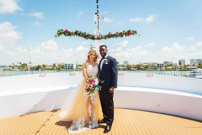 couple posing on boat deck
