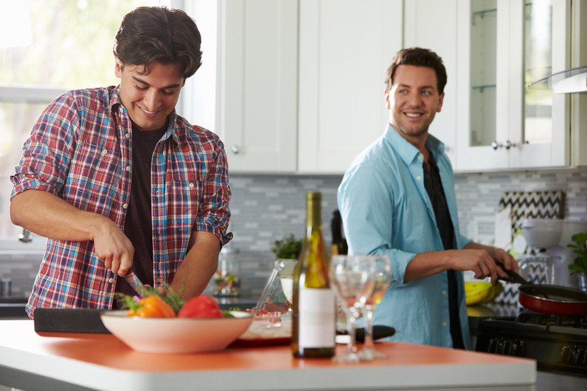 LGBTQ+ couple preparing a meal in the kitchen
