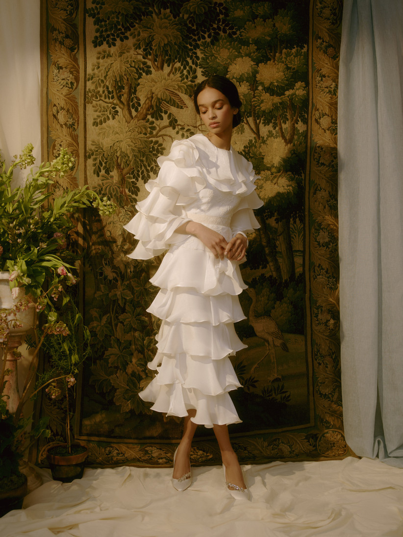 wedding dress with ruffled tiers and long sleeves