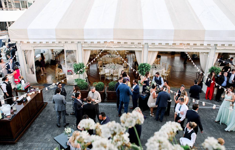 aerial view of outdoor reception space with tent and string lights at rhode island wedding venue