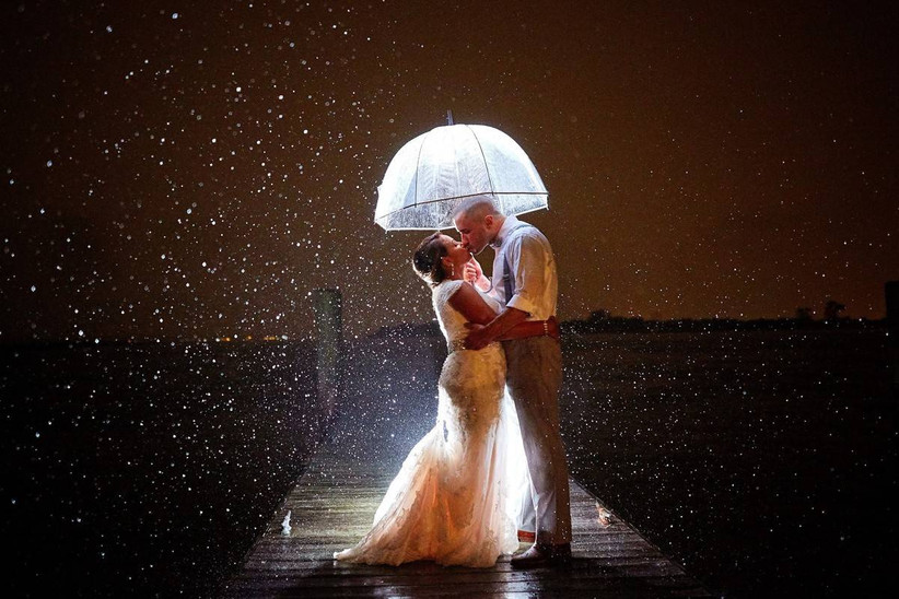 nighttime rain wedding couple