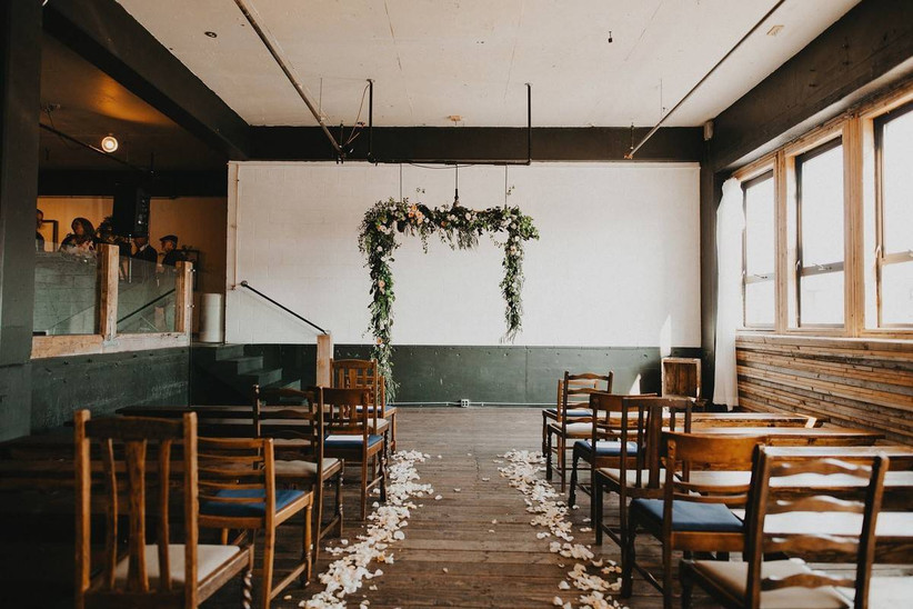 modern wedding venue in oregon industrial space with hardwood floors and paneled walls