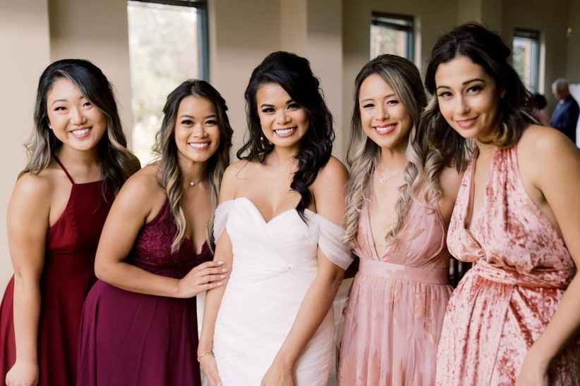 Bride and bridesmaids posing for a group photo