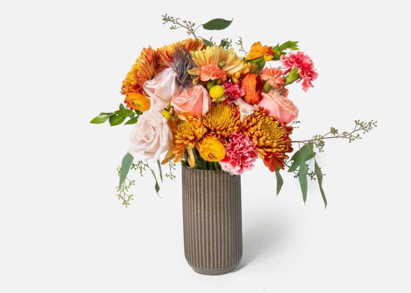 Vase filled with beautiful flowers housewarming gift for couples