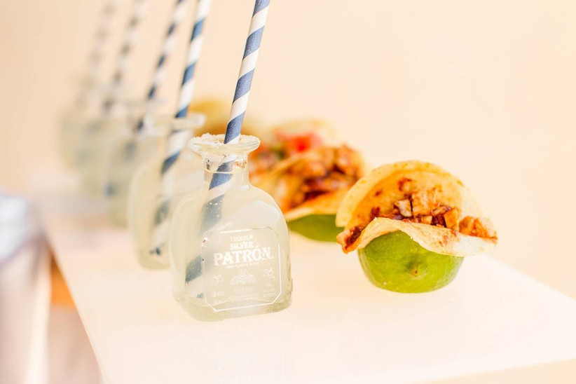mini tacos and patron bottles with striped paper straws