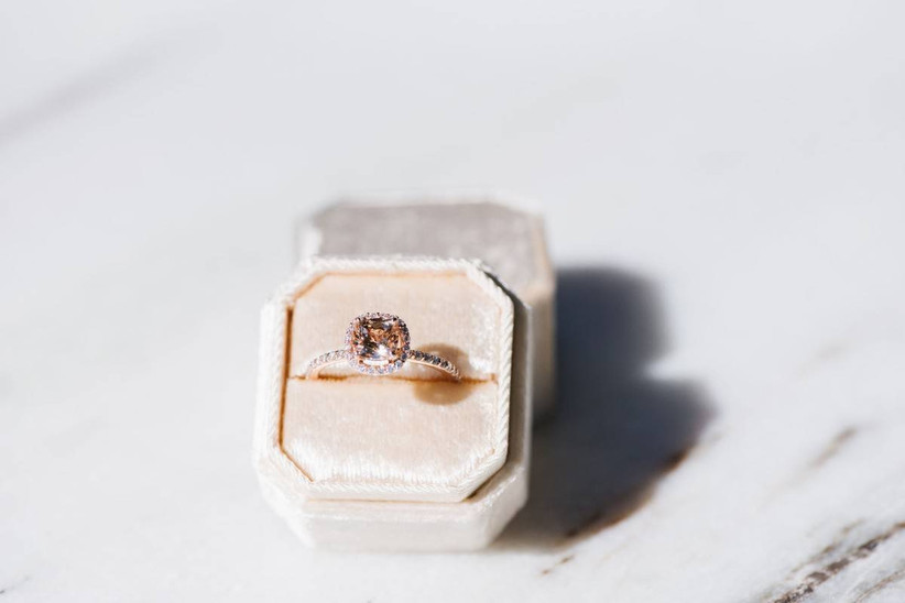 cushion-cut morganite engagement ring with halo setting in a pink velvet ring box