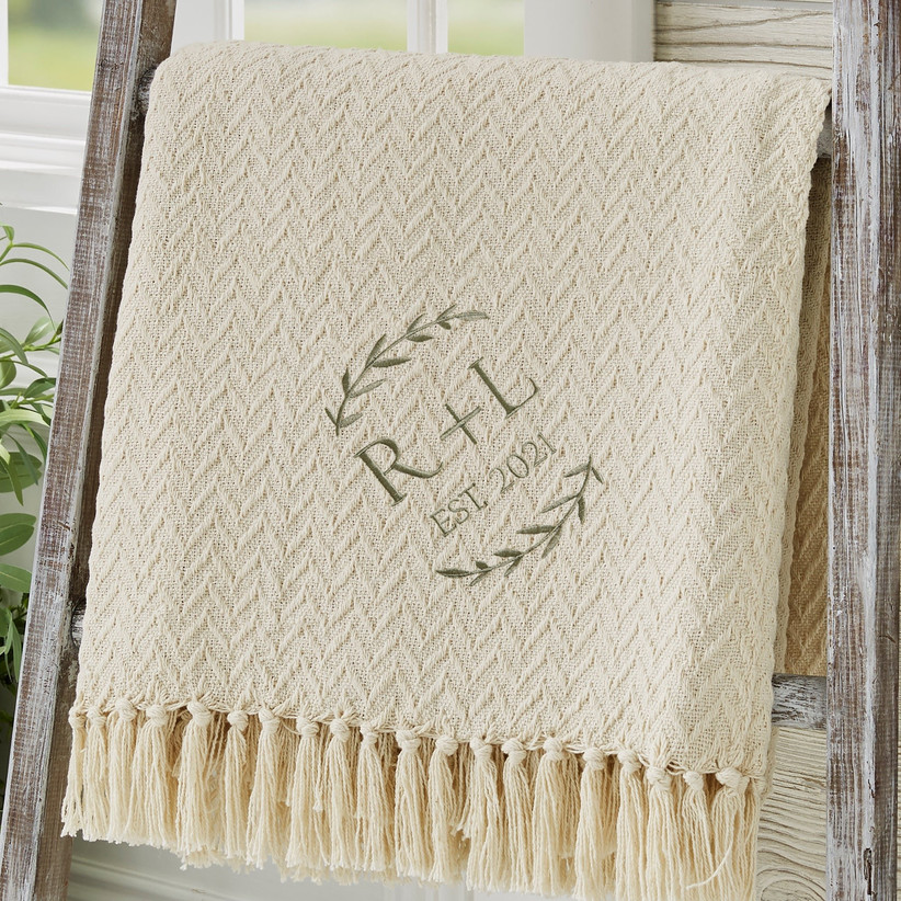 Elegant cotton afghan embroidered with couple's initials and established date