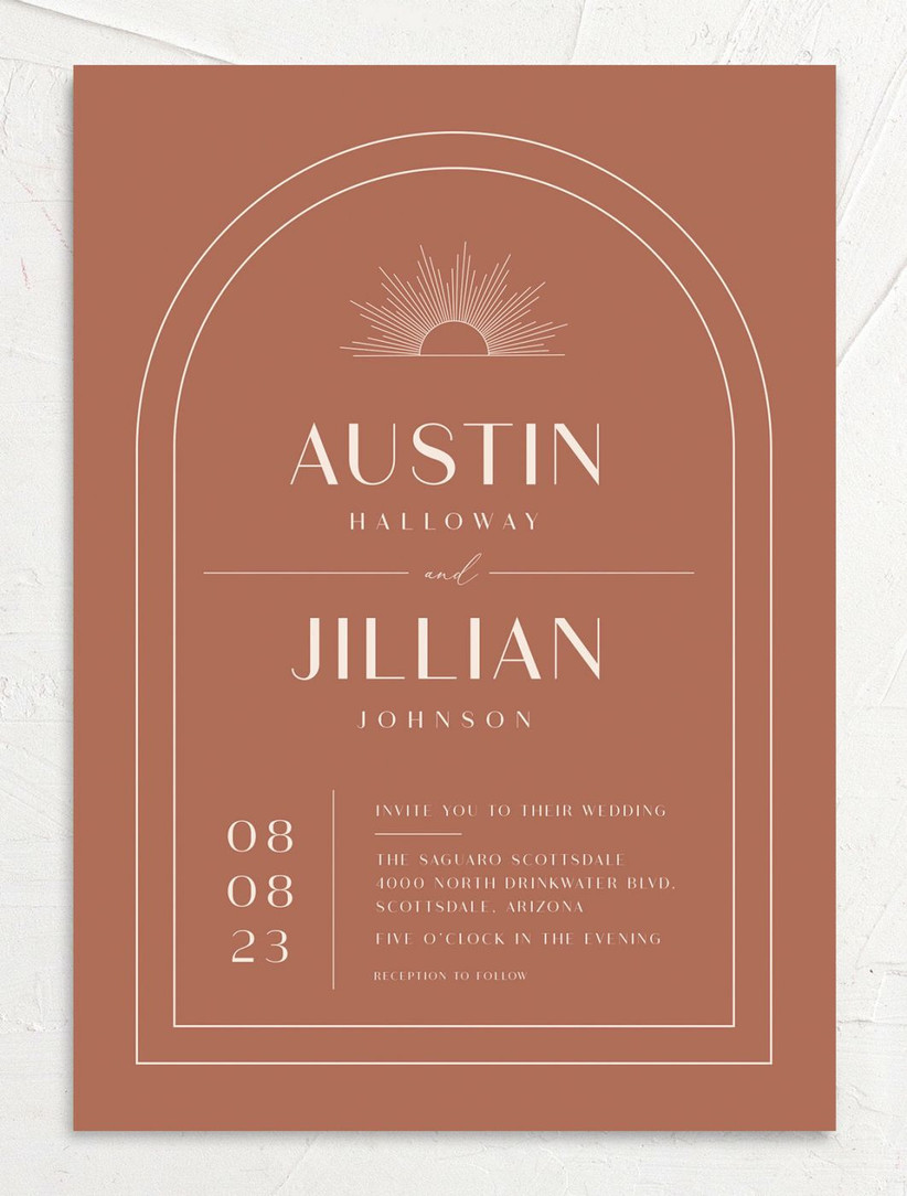 boho fall wedding invitation rust orange background with white arched border and modern font