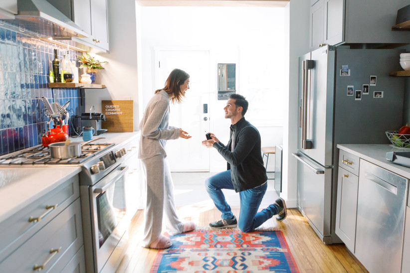at-home proposal couple in pajamas kitchen engagement