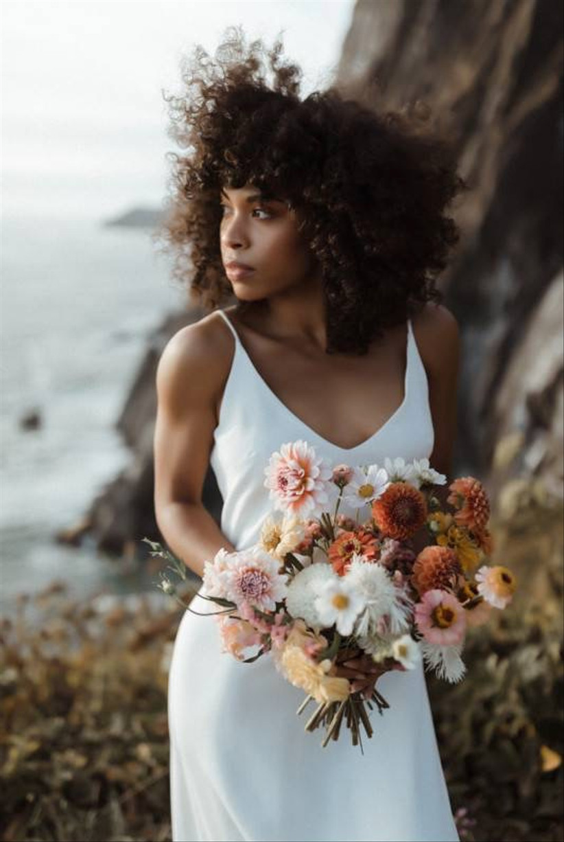 modern alternative beach wedding bouquet with peach zinnias and pink wildflowers