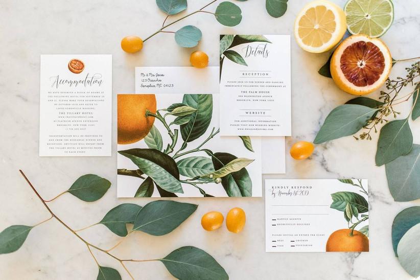 wedding invitation suite decorated with oranges