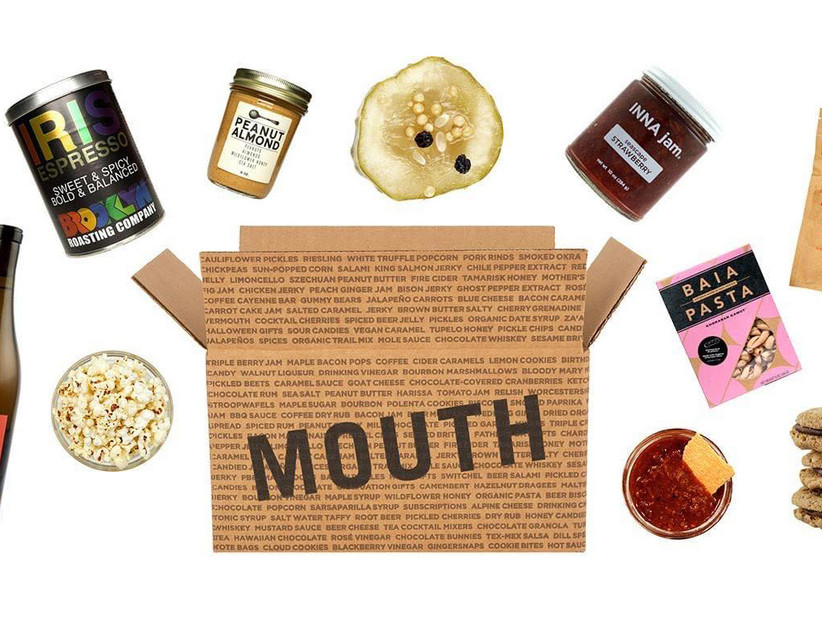 Mouth subscription box with a selection of snacks