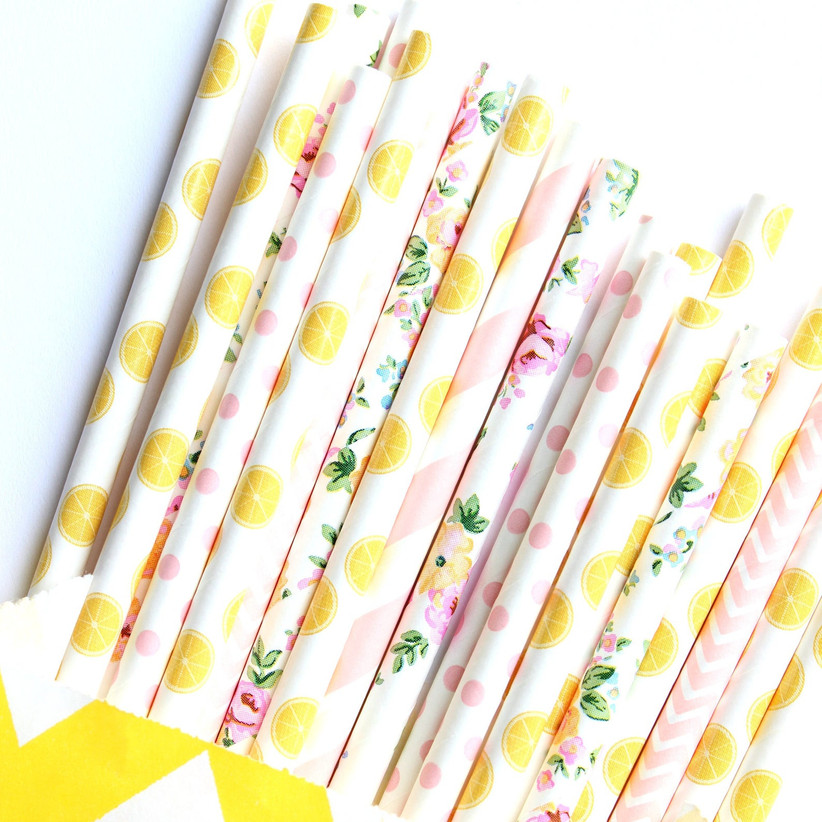 Close up of summer themed drinking straws with lemon, floral, polka-dot, and striped patterns