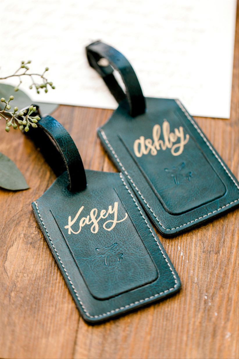 travel themed wedding escort cards made from leather luggage tags