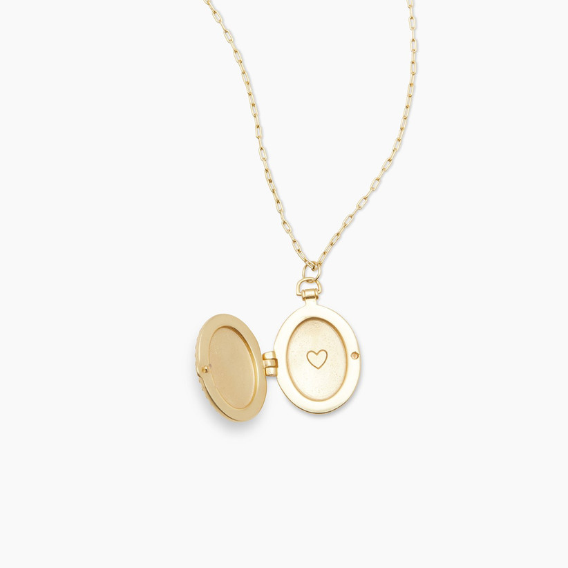 Yellow gold locket with heart engraved inside