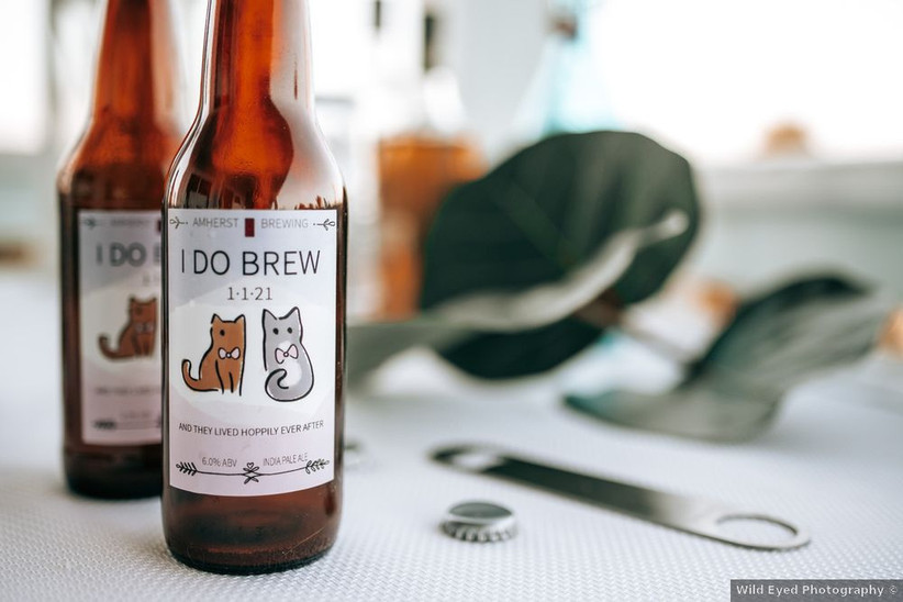 beer bottles with custom wedding labels that say