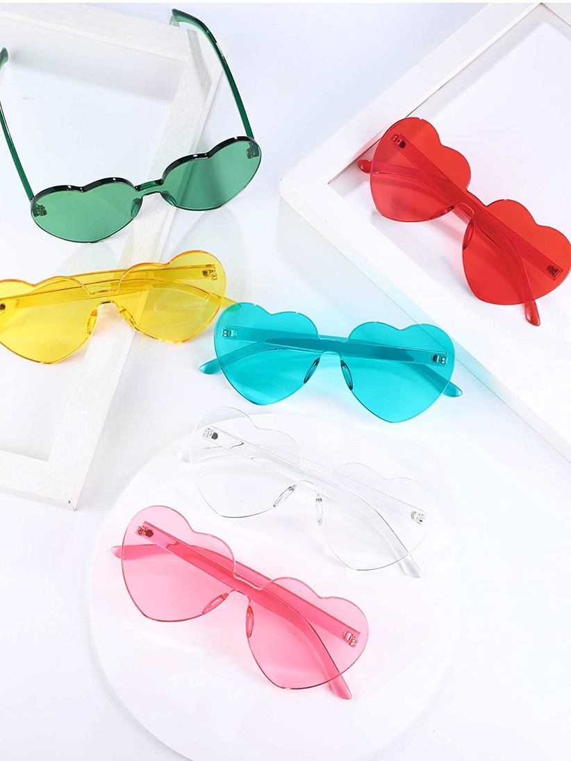 assortment of colorful heart-shaped sunglasses in yellow, red, blue, pink