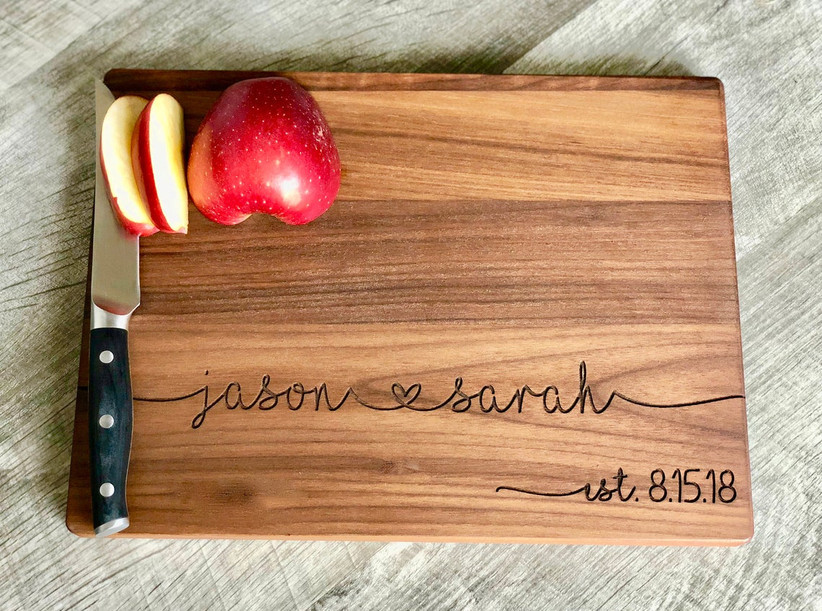 Wooden cutting board personalized with couple's names and date