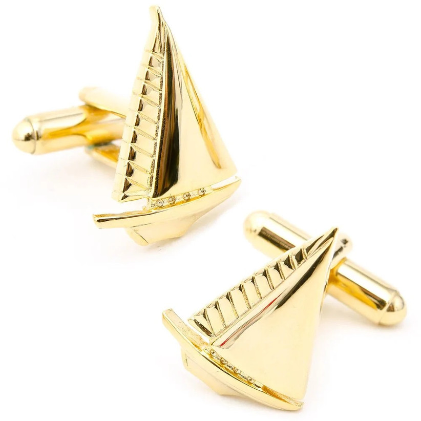 Yellow gold cuff links in the shape of sailboats