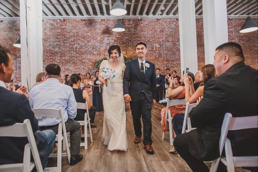 wedding recessional in indoor industrial space