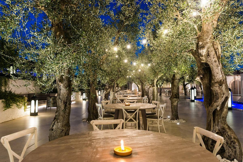 intimate italy wedding venue with reception tables scattered among tree groves