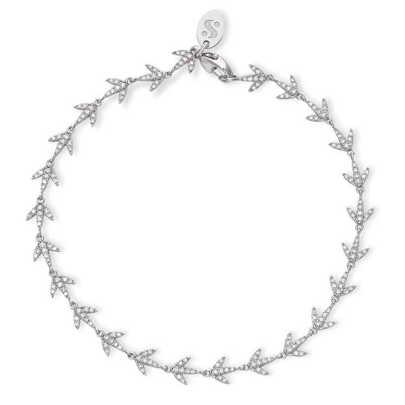 Dainty diamond path bracelet on gray background