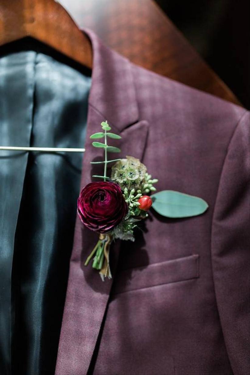 burgundy ranunculus wedding boutonniere with greenery