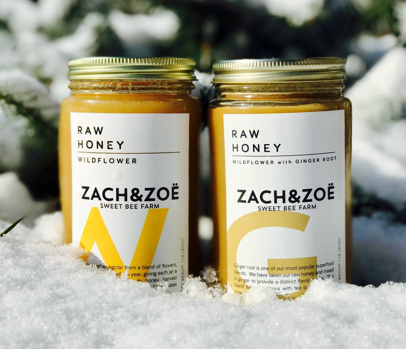 Raw wildflower honey and raw wildflower honey with ginger root jars