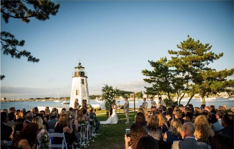 wedding ceremony with lighthouse backdrop