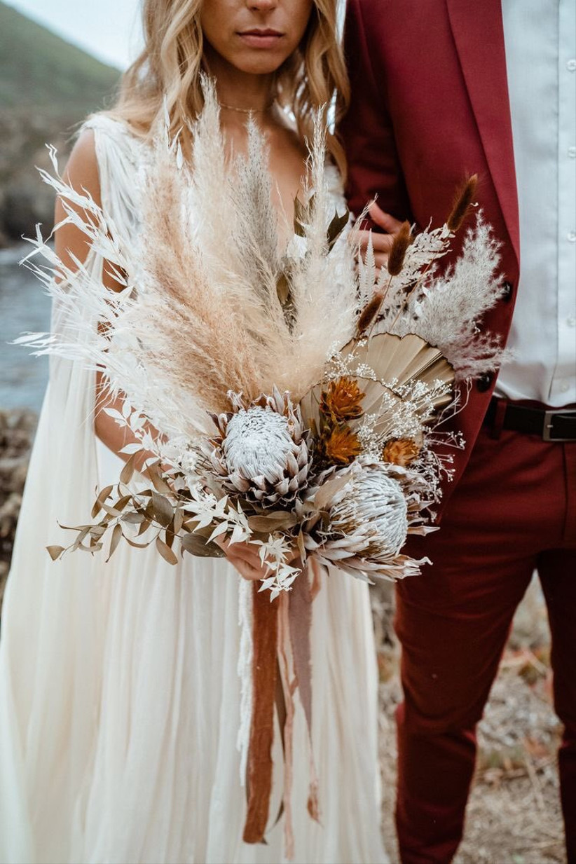 boho protea bouquet with dried greenery, pampas grass and bleached italian ruscus