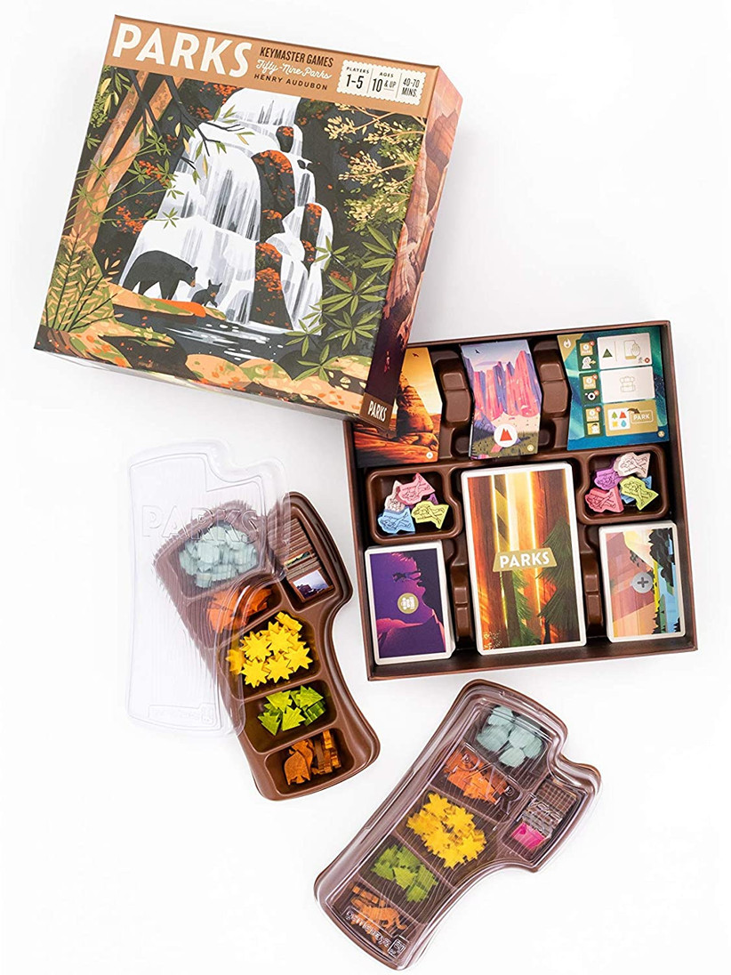 Beautifully illustrated PARKS game box with picture of bears and a waterfall