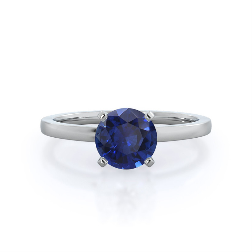 Sapphire solitaire engagement ring with white gold band