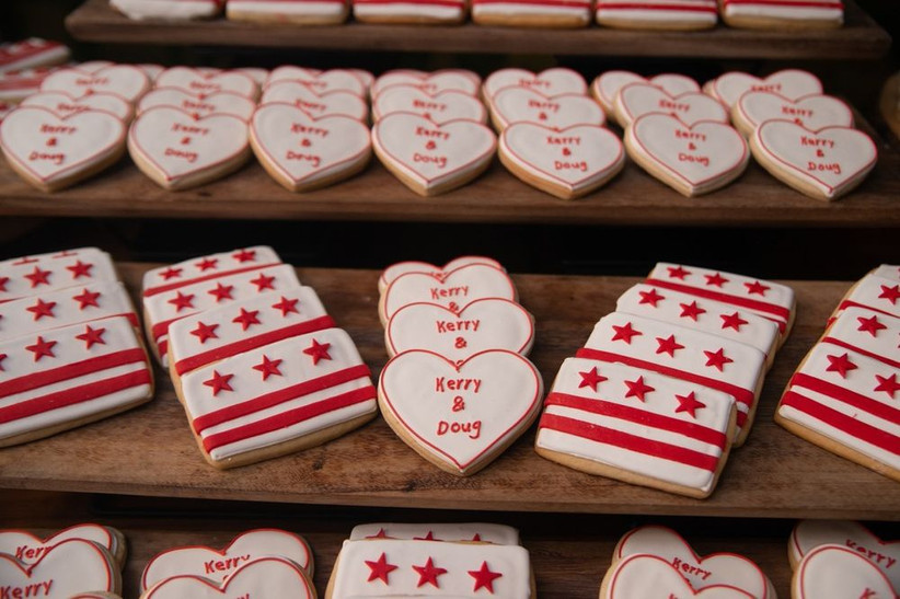 custom heart-shaped wedding cookies with piped icing that says
