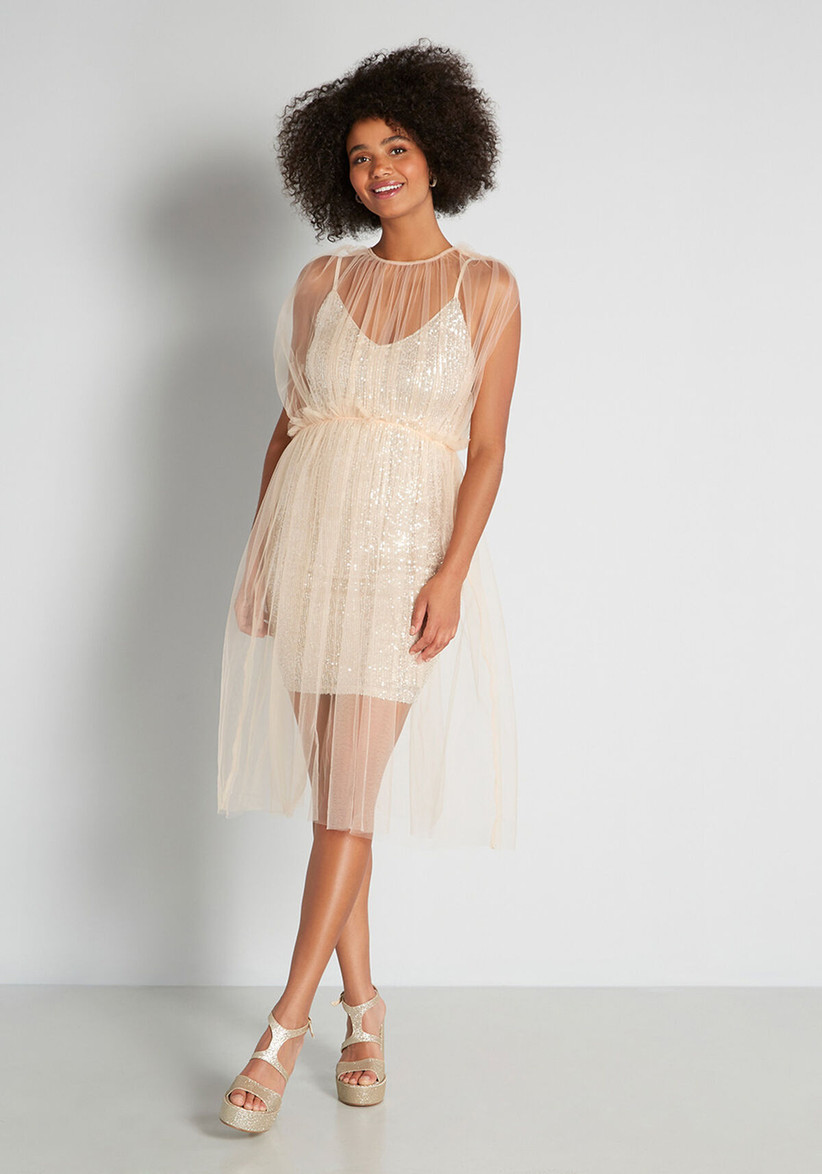Sparkly rehearsal dinner dress with tulle overlay