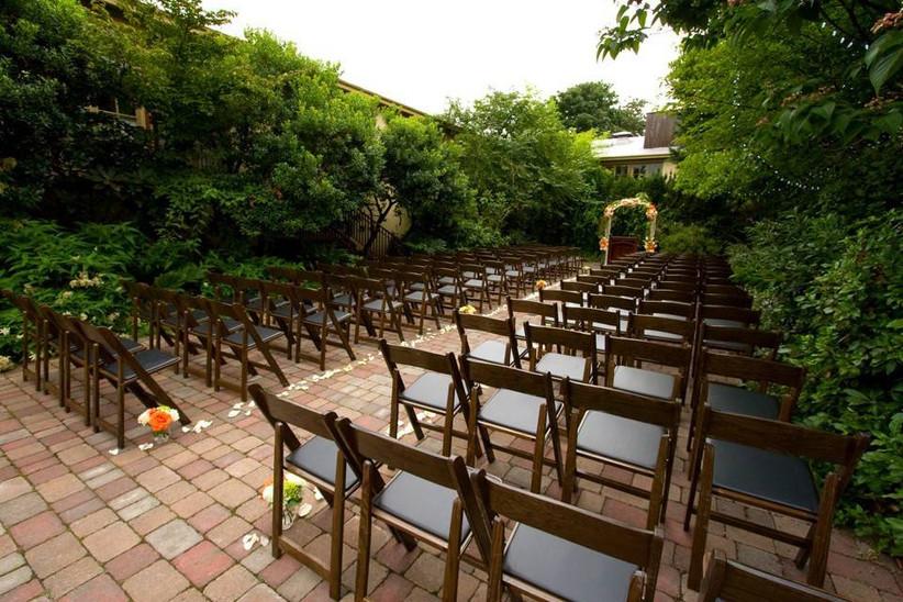 outdoor wedding ceremony in enclosed brick courtyard