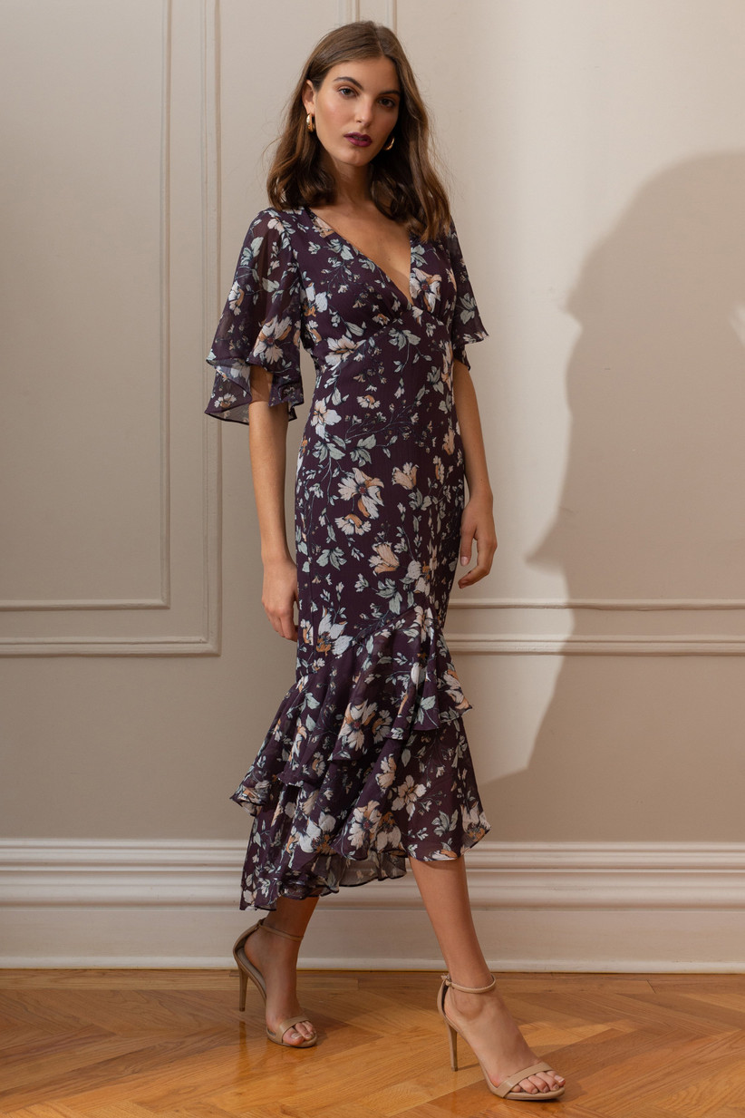 Floral midi fall wedding guest dress with flutter sleeves and tiered skirt