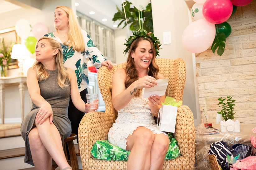 bride opening shower gifts