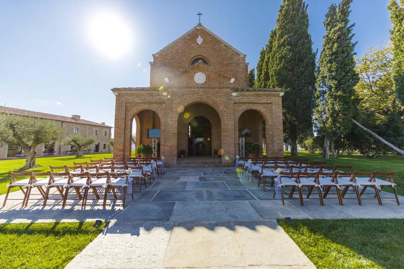 outdoor wedding ceremony in front of chapel at italy wedding venue