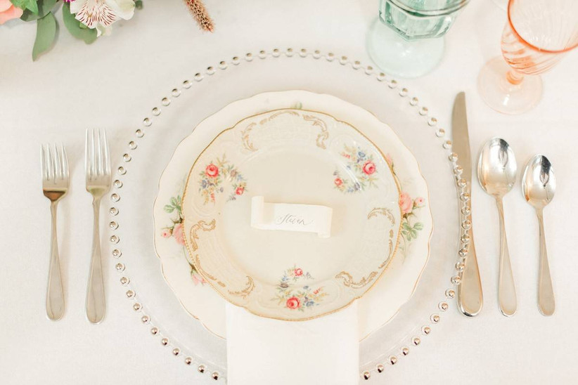 wedding reception place setting with vintage floral china and silverware