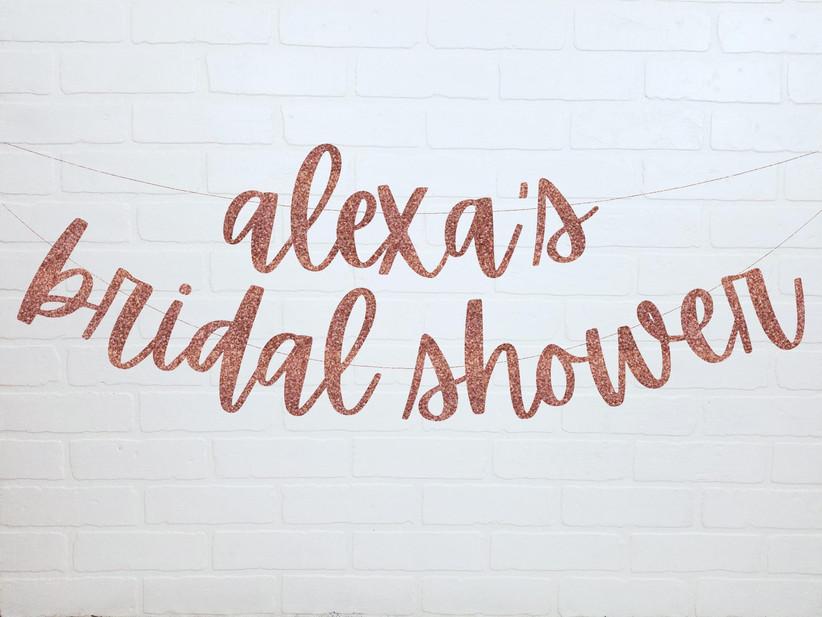 Personalized rose gold bridal shower banner reading Alexa's Bridal Shower