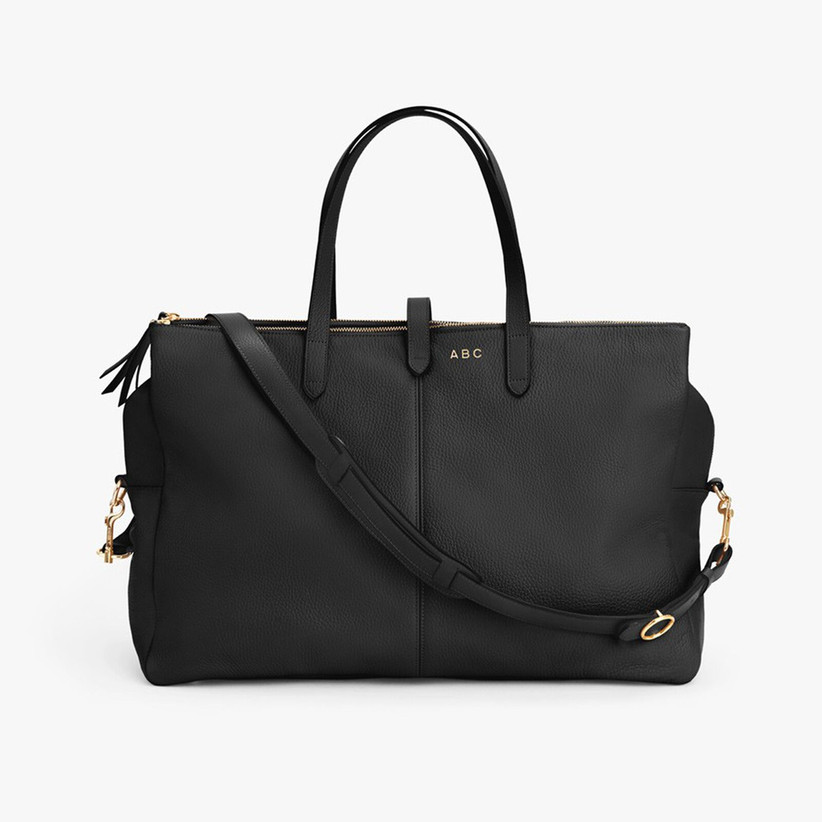 Black leather weekend bag with gold ABC monogram