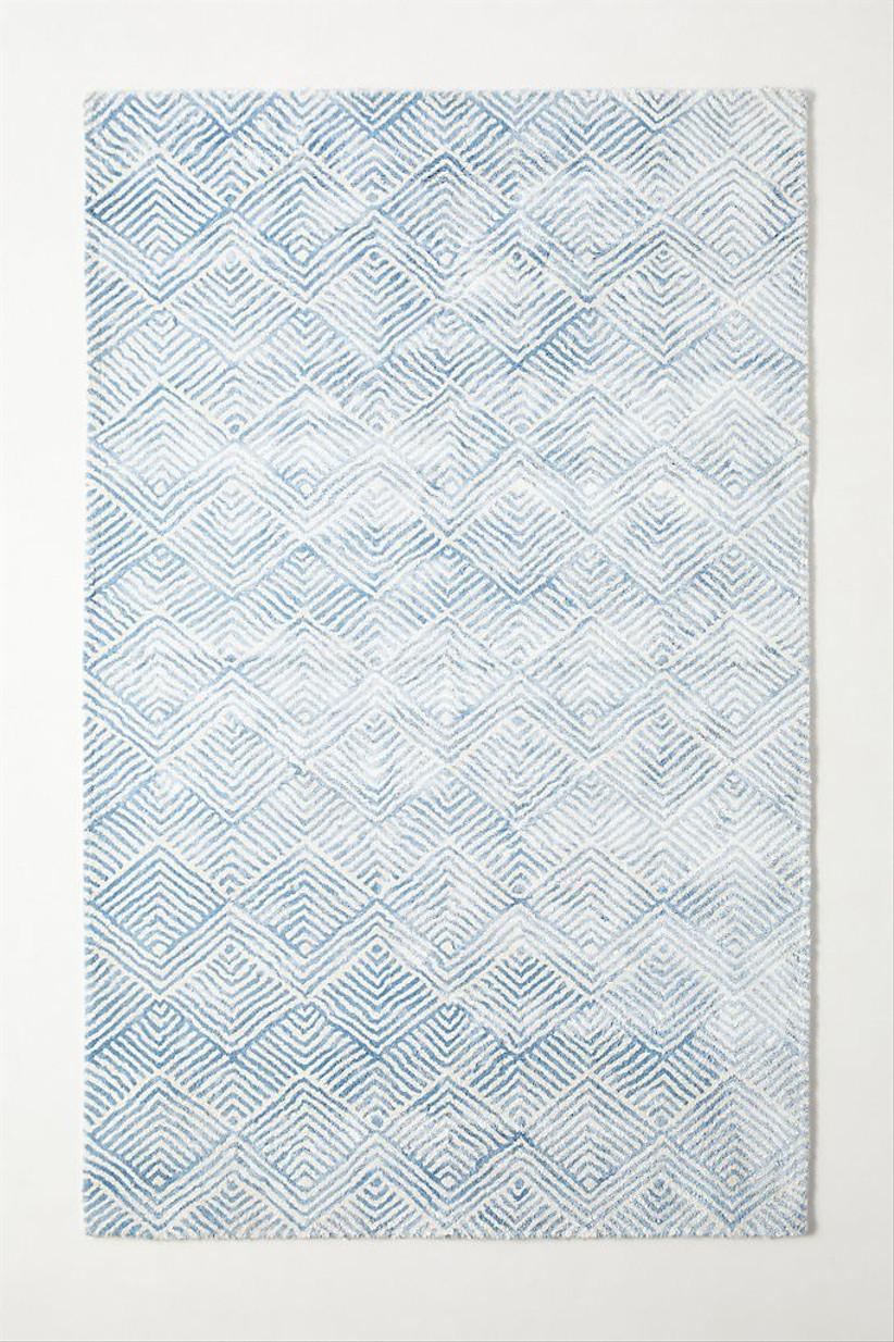 blue and white geometric design rug